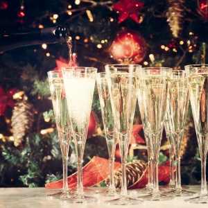 Filling Up Glasses For Party. Glasses Of Champagne With Christma